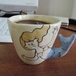 assa.さんの人形のマグカップ