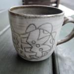 岡田育子さんのイラストマグカップ