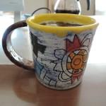 栢野紀文さんの黄色の縁取りマグカップ